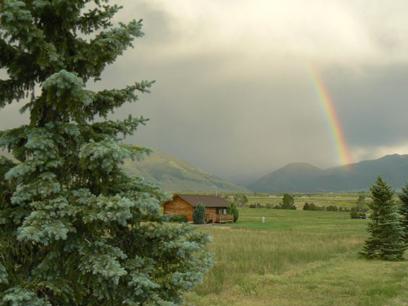 Johnstad's Log Cabin and rainbow