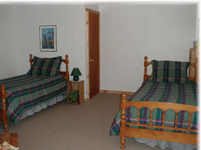 Johnstad's Log Cabin bedroom with twin beds